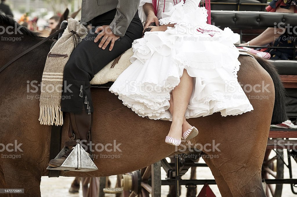 Rider and woman with typical suit royalty-free stock photo