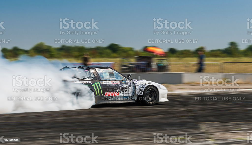 Rider Dmytro Illyuk  on the car brand Nissan stock photo