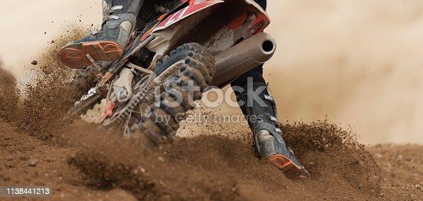 Rider driving in the motocross race the rear wheel motocross bike
