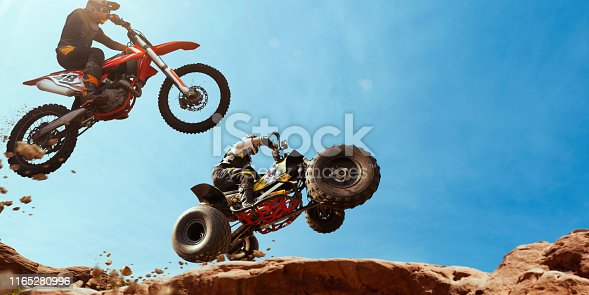 Quad bike rider in the action with motocross  rider.
