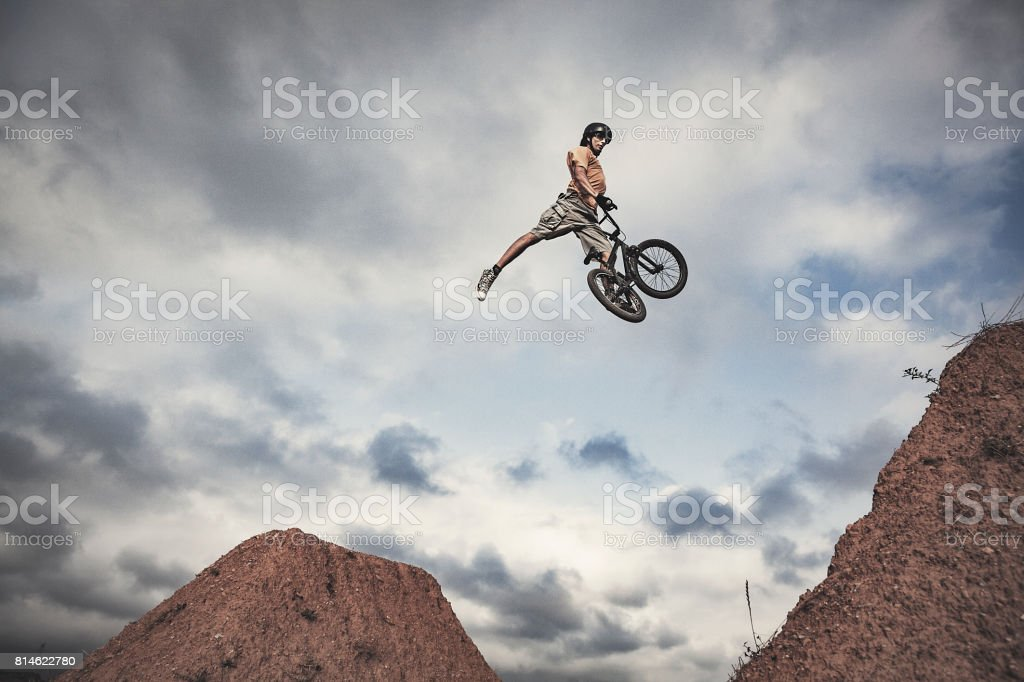 BMX rider jumping high Real jump stock photo