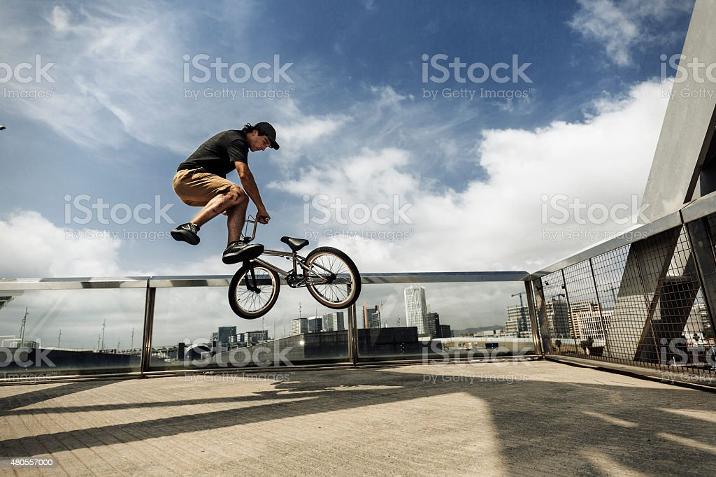 BMX rider jumping in the city stock photo