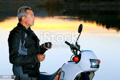 istock Rider Man Drinking coffee near His Motorcycle 180819729
