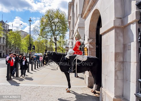 istock Rider of horse guard in Whitehall, London, UK 1221425372