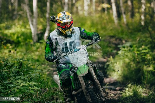 Sludorudnik, Russia - August 16, 2015:  rider overcomes mud puddle during