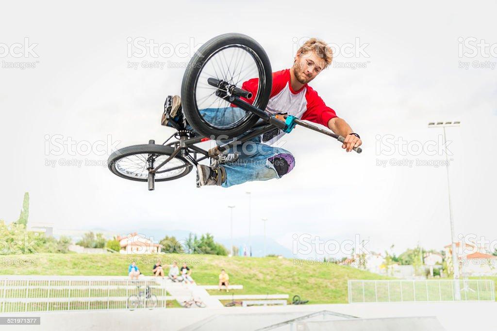 BMX rider in performing tricks.