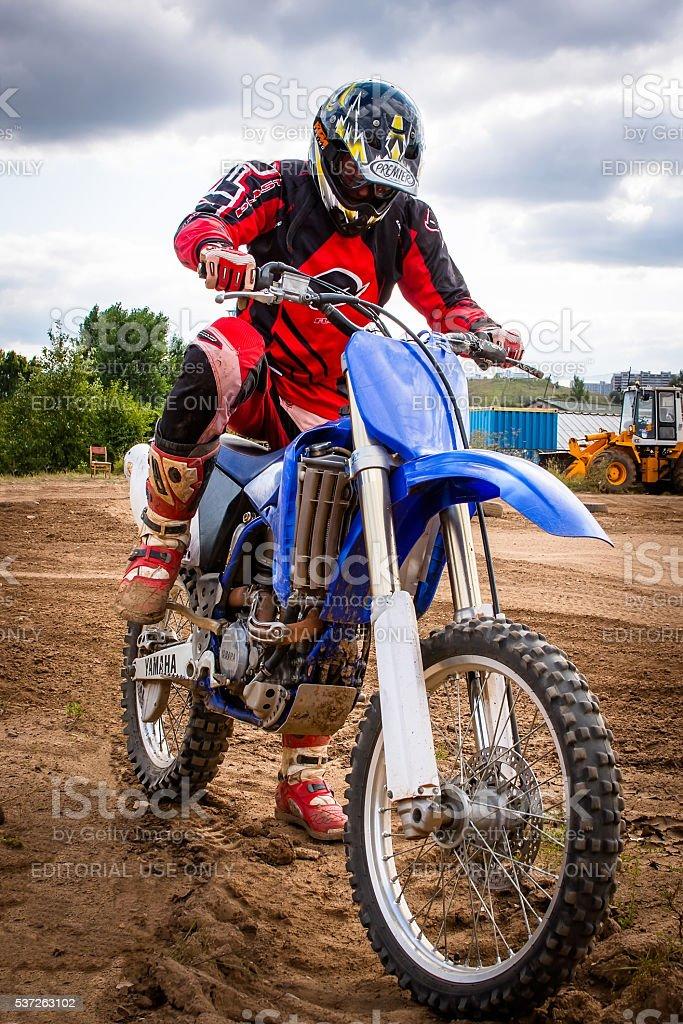 Rider sitting on motorcycle stock photo