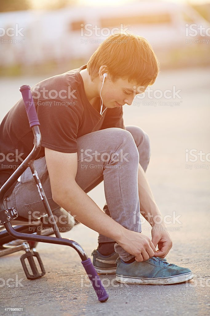 Rider tying laces stock photo