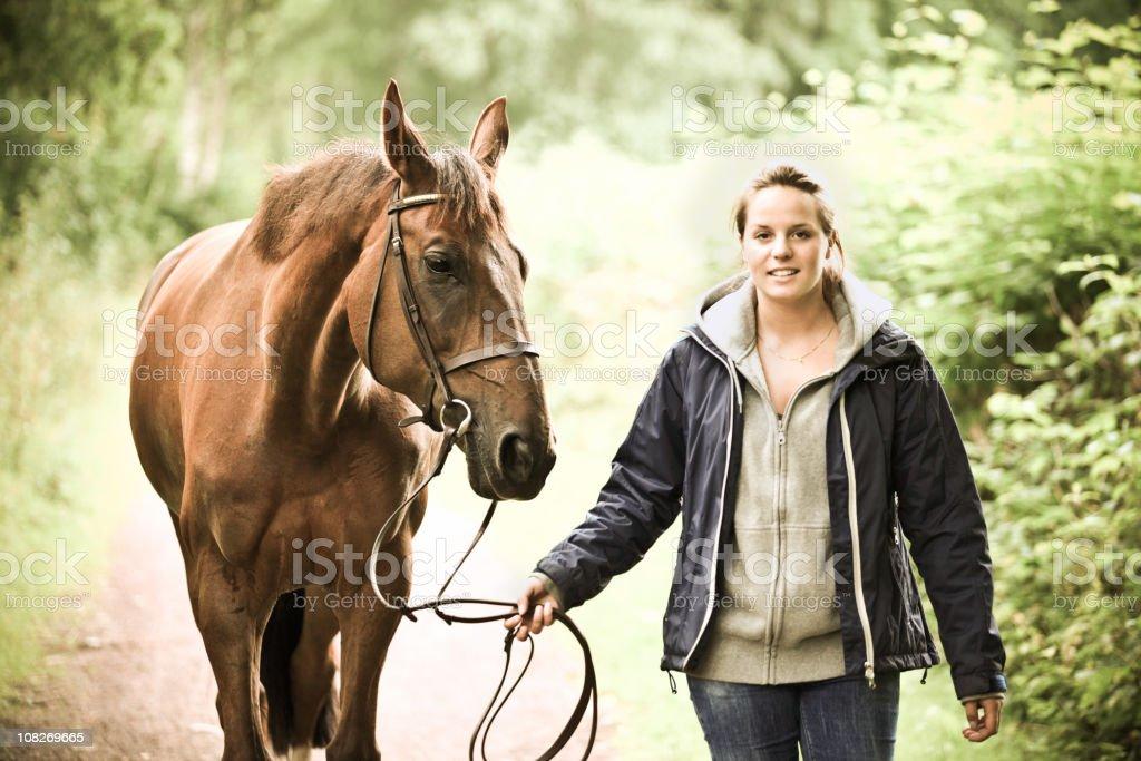 Rider walking her horse stock photo