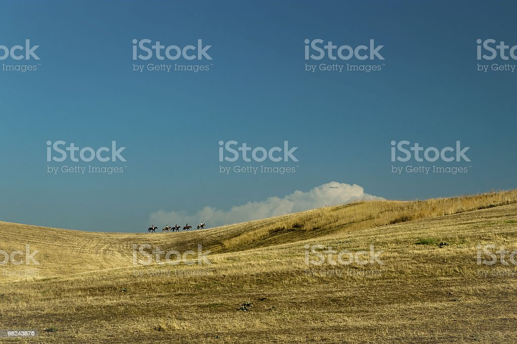 Riders and a cloud royalty-free stock photo