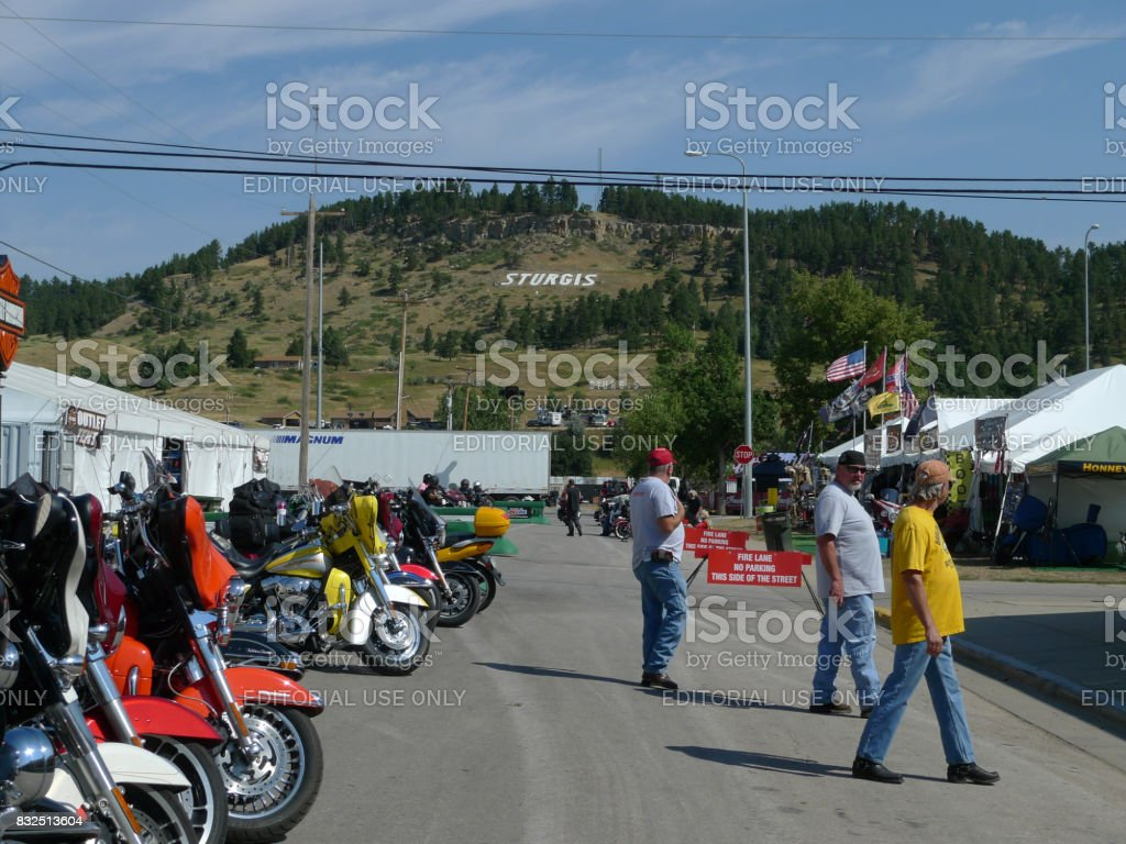 Sturgis, South Dakota - August 4, 2017: Riders, motorcycles and the word 'Sturgis' on the mountain stock photo