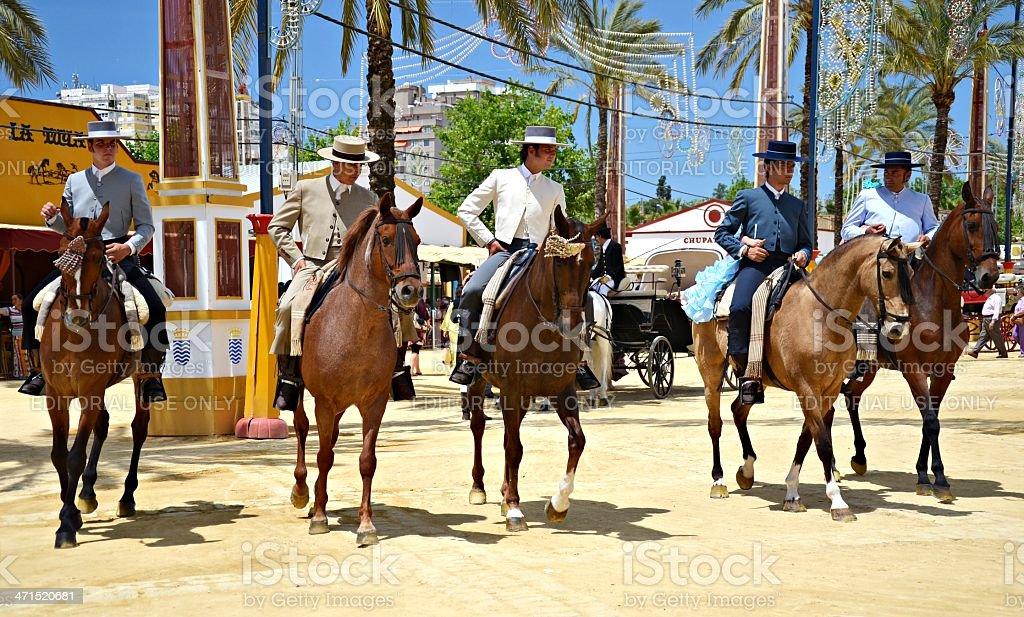 Riders on horseback walking royalty-free stock photo
