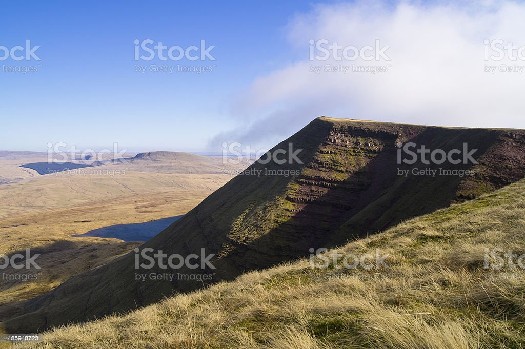 Ridge of Fan Brycheiniog catches the late afternoon sun stock photo