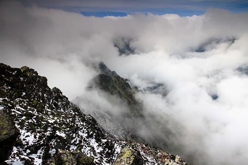 Ridge of Slavkovsky peak and Velka Studena valley in clouds