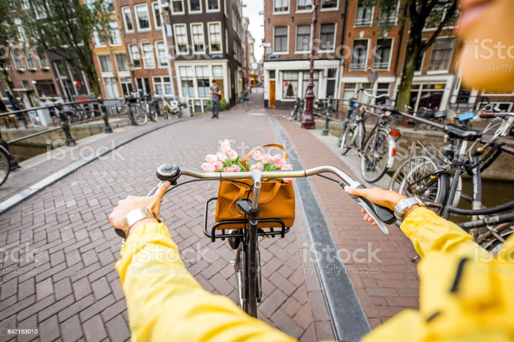 Riding a bicycle in Amsterdam stock photo