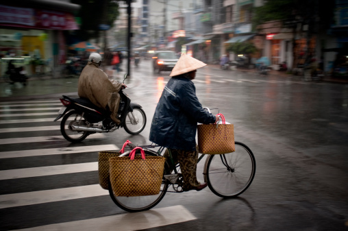 Riding A Bicycle In The Rain In Nha Trang, Vietnam