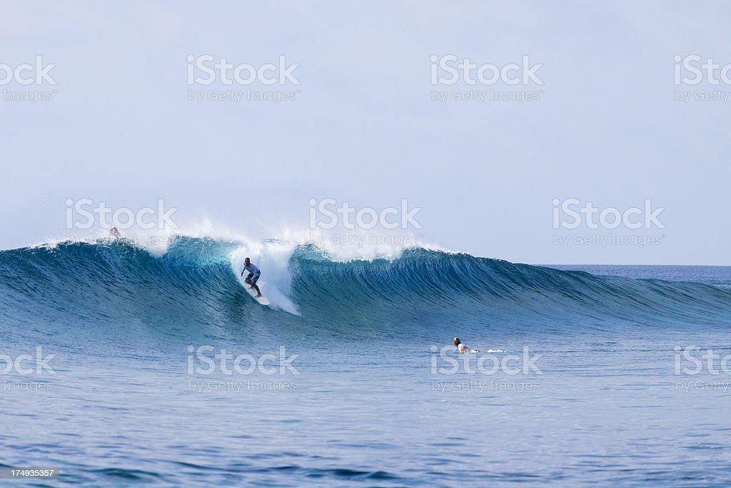 Riding a big wave stock photo