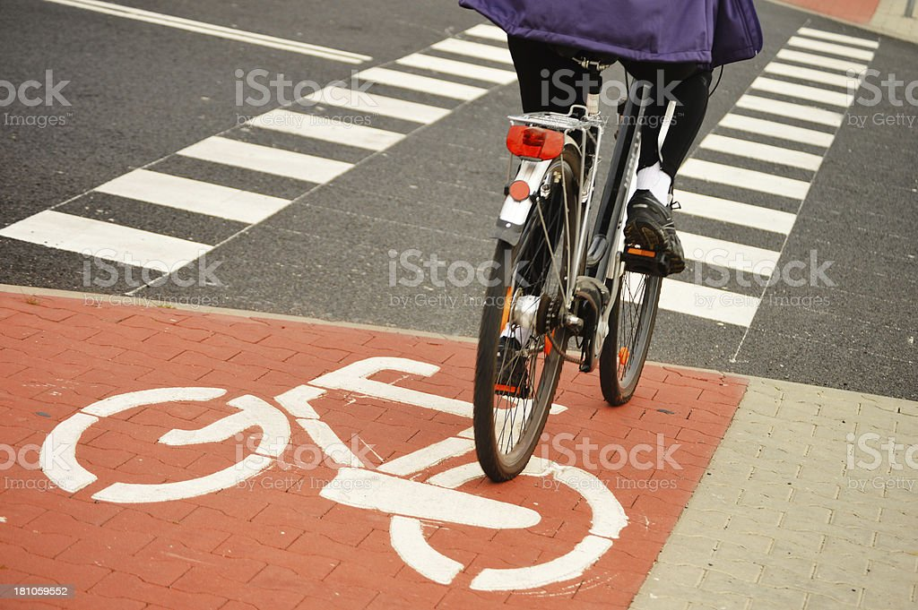 Riding a bike on bicycle road sign stock photo