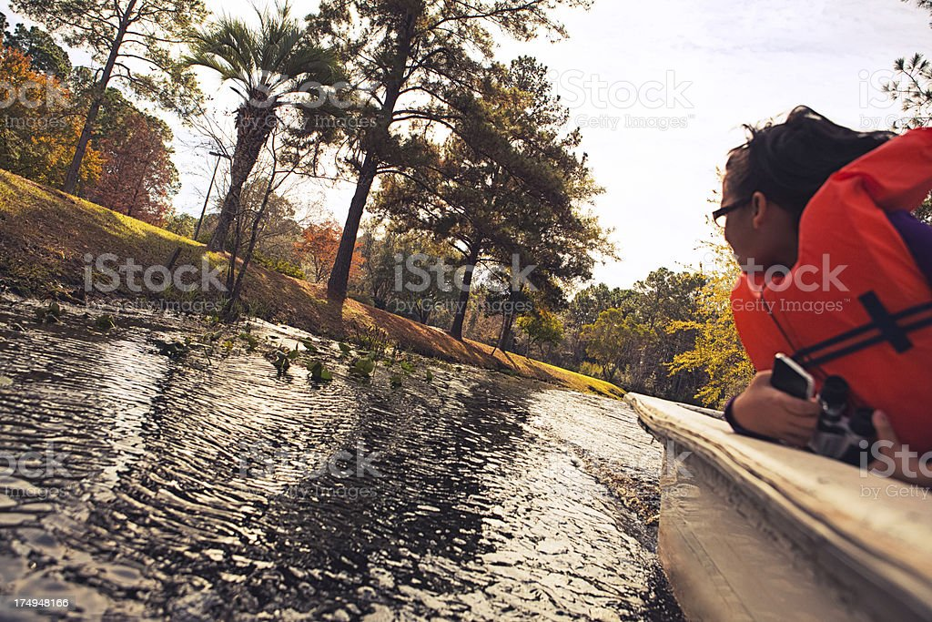 riding a boat through the swamp royalty-free stock photo