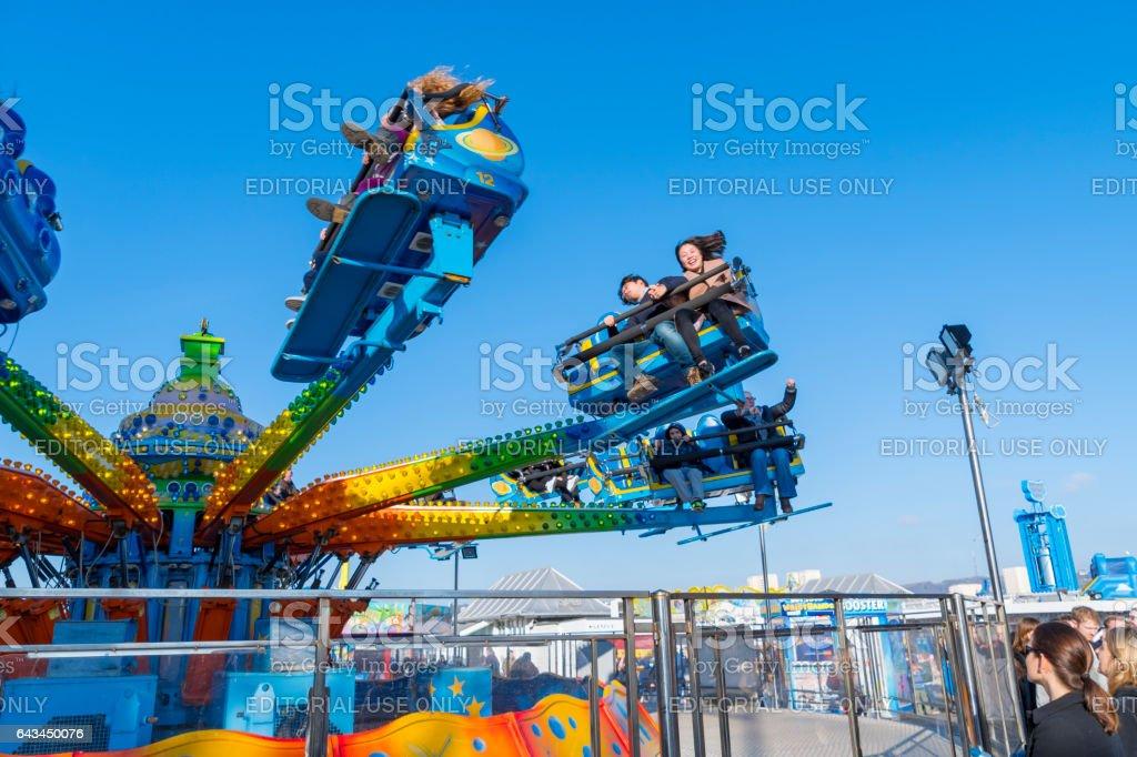 Riding a funfair ride on Brighton Pier stock photo
