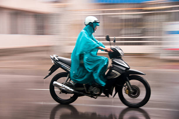 riding a motorcycle in the rain - motorbike, umbrella stock pictures, royalty-free photos & images