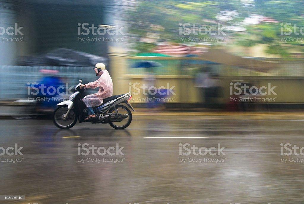 Riding A Motorcycle Through A Storm In Nha Trang, Vietnam stock photo