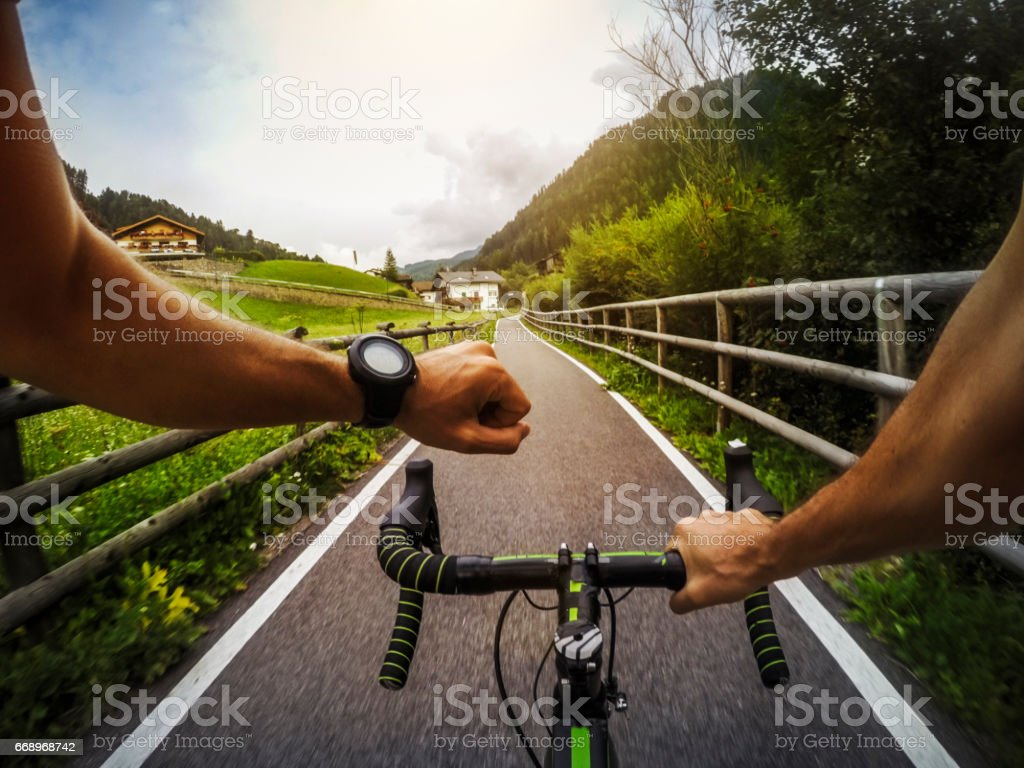 POV riding a road racing bicycle in the forest foto stock royalty-free