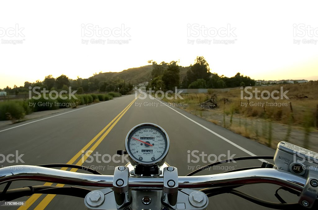 Riding a straight road stock photo