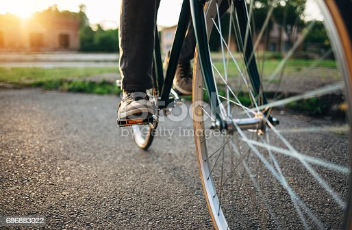 Low angle view of bicycle rider cycling at sunset.