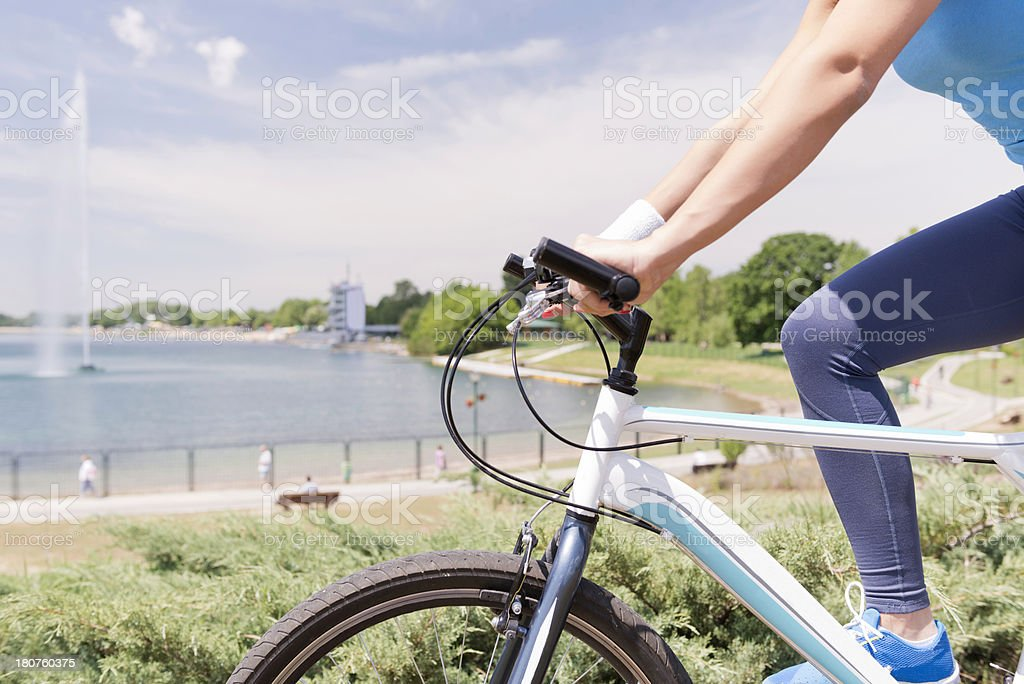 Riding bicycle by the lake stock photo