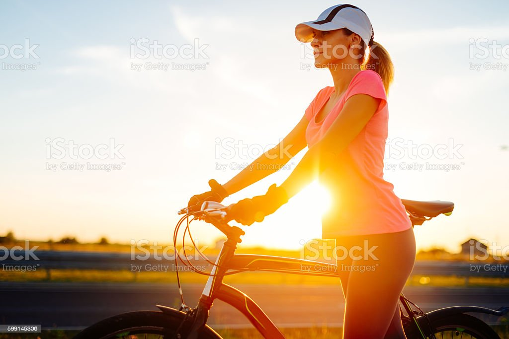 Riding bicycle for health and fit body stock photo
