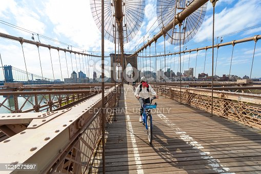 New York City, USA - April 25, 2020: Normally crowded Brooklyn bridge is empty with very few people due to the coronavirus pandemic in New York City.