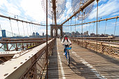 istock Riding bicycle on the Brooklyn Bridge during the covid-19 pandemic 1221272697