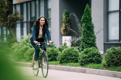 istock riding bicycle 892647368