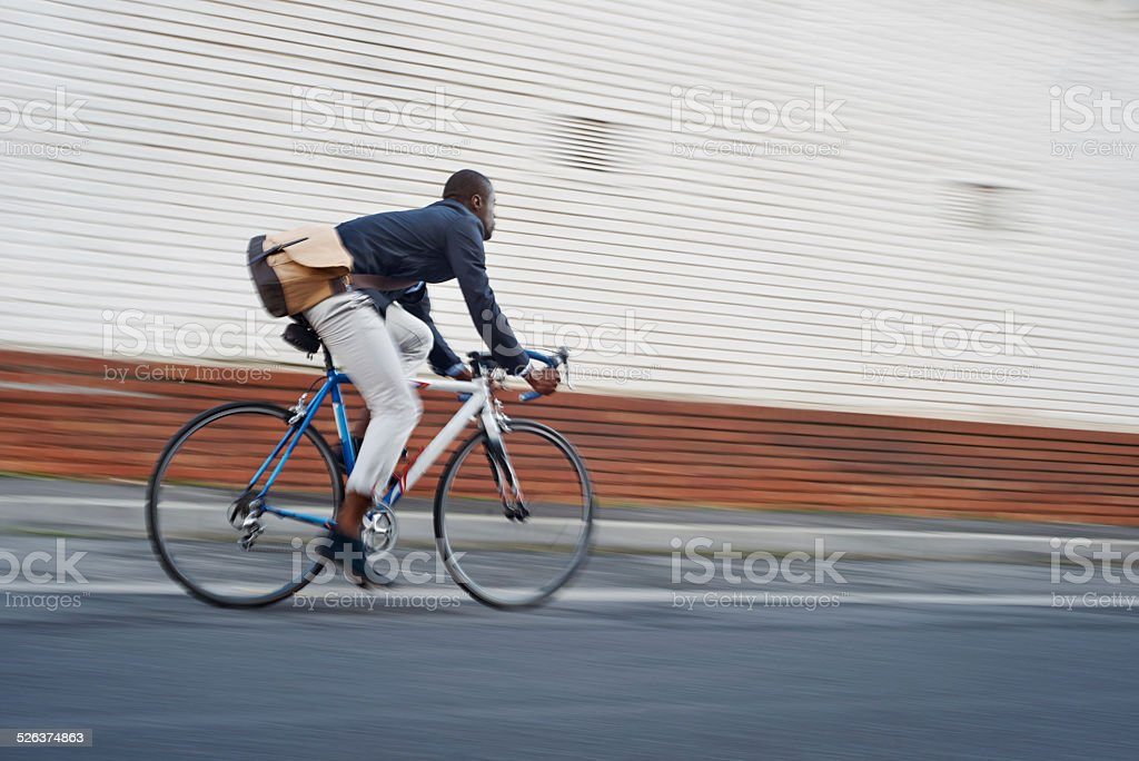 riding bike black man stock photo