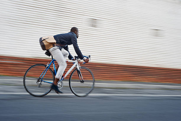 riding bike black man - rusningstid bildbanksfoton och bilder