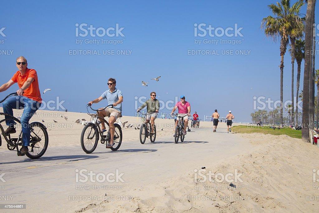 Riding bikes at Venice bach royalty-free stock photo