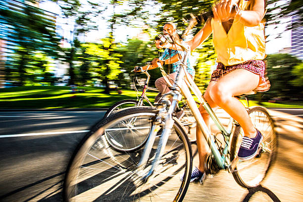 Riding bikes in Central Park, New York stock photo