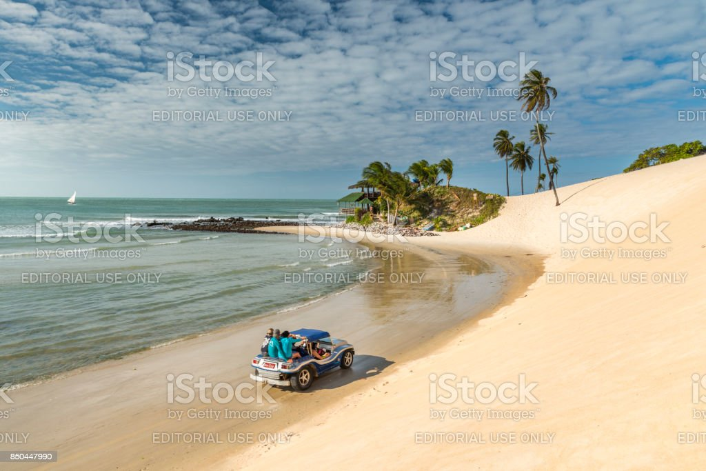Riding Buggy Bugre offroad in Genipabu beach Natal stock photo