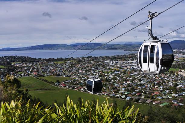 Riding cable car above Rotorua North Island New Zealand Riding cable car above Rotorua lake and city, in the centre of North Island of New Zealand rotorua stock pictures, royalty-free photos & images