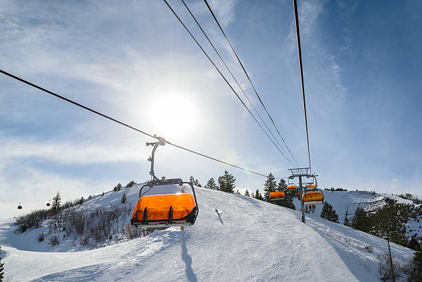 Riding Chairlift in Winter stock photo