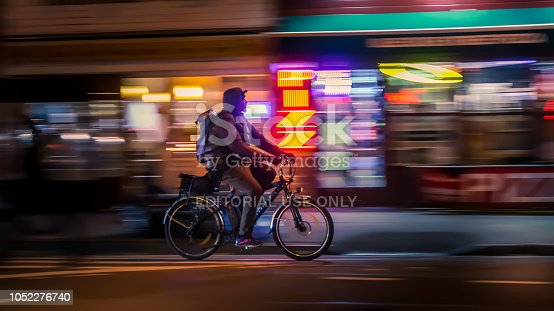 929609038istockphoto Riding cyclists 1052276740