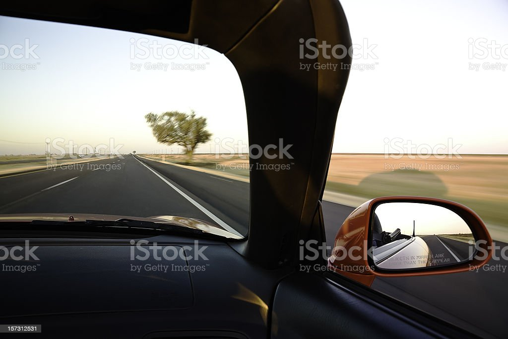 riding down the highway in a red convertible sports car royalty-free stock photo