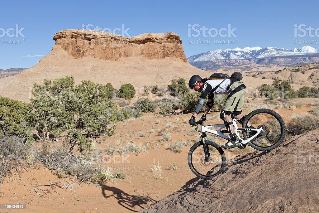 Riding down to the sand, Moab, Utah stock photo