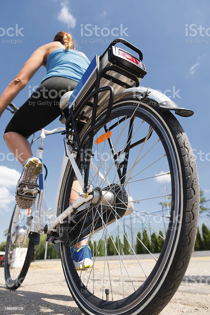 Riding e-bike or electric bicycle stock photo
