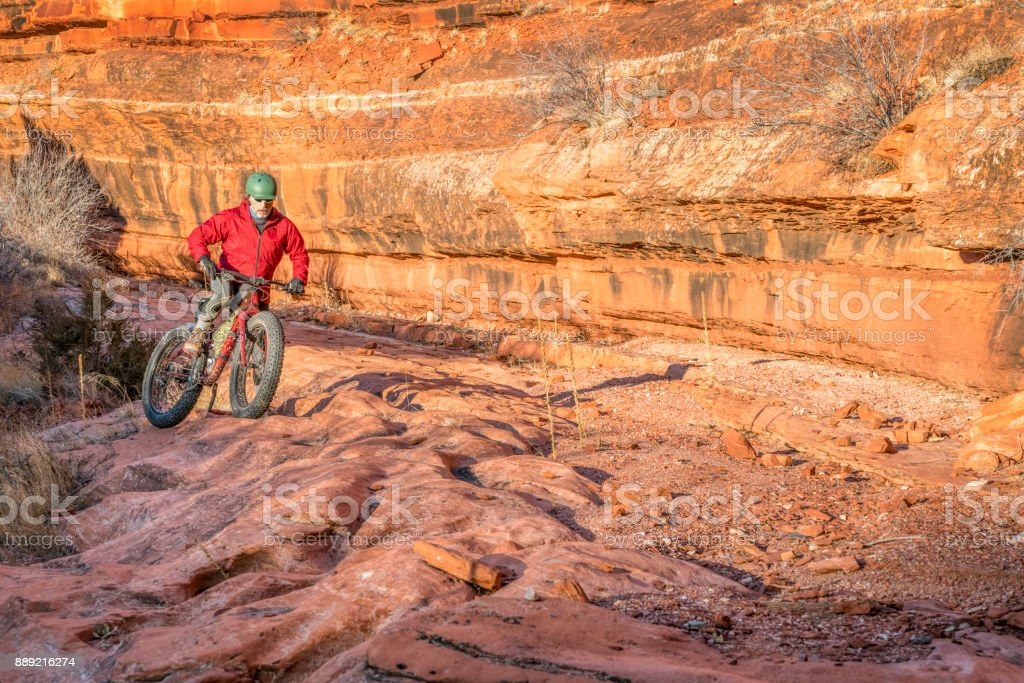 Riding Fat Bike On Slickrock At Canyon Bottom Stock Photo & More