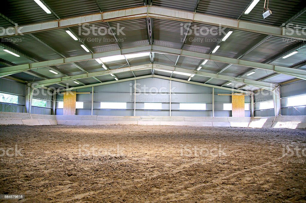 Riding hall with sandy covering without people stock photo