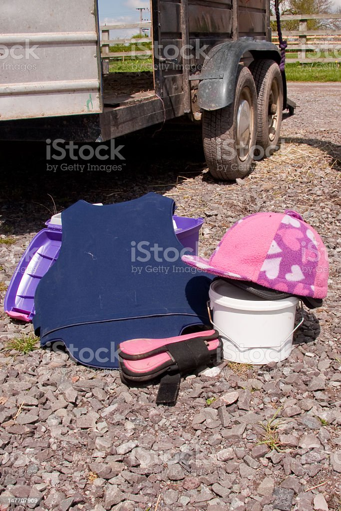 Riding hat body protector and jump boots by trailer stock photo