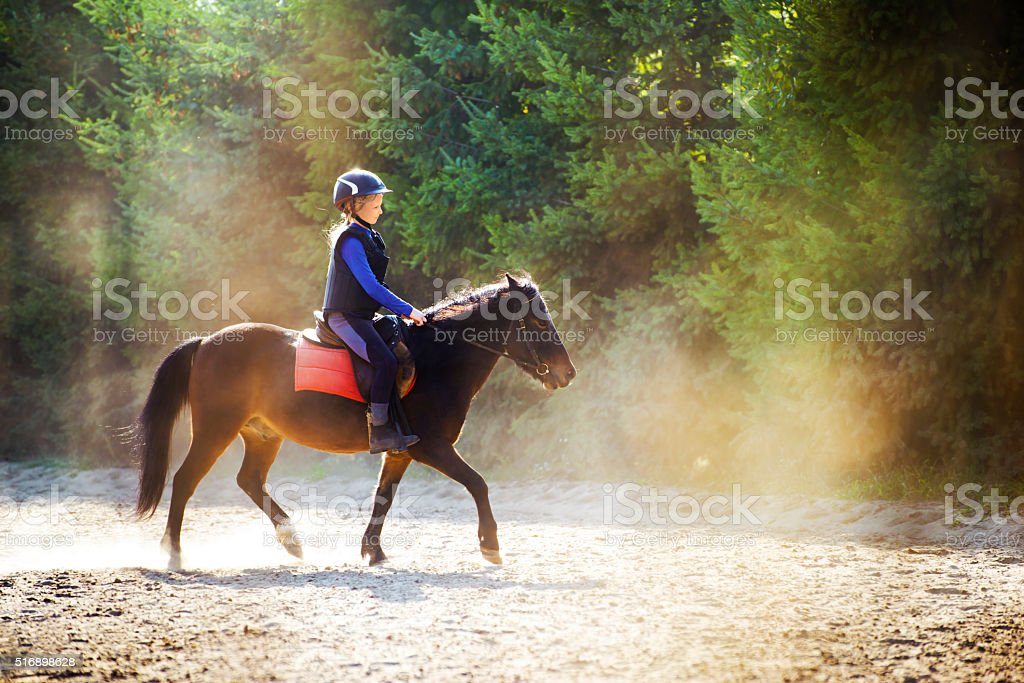 Riding in dust stock photo