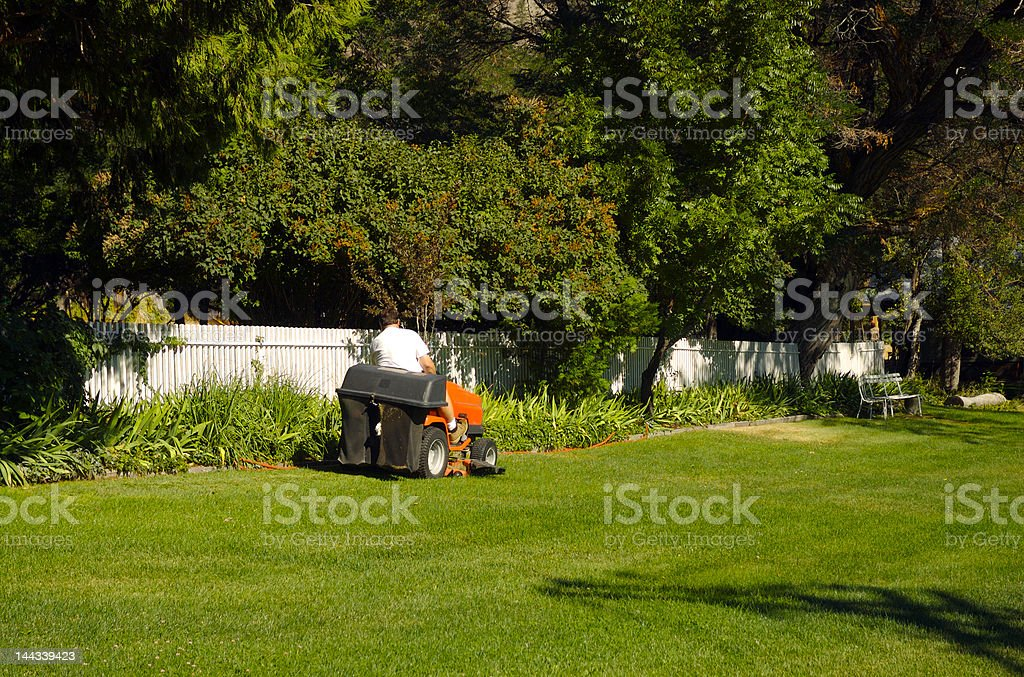 Riding lawn mower stock photo